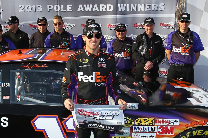 Denny Hamlin, driver of the #11 FedEx Express Toyota, poses after qualifying for the pole position in the NASCAR Sprint Cup Series Auto Club 400 at Auto Club Speedway on March 22, 2013 in Fontana, California.