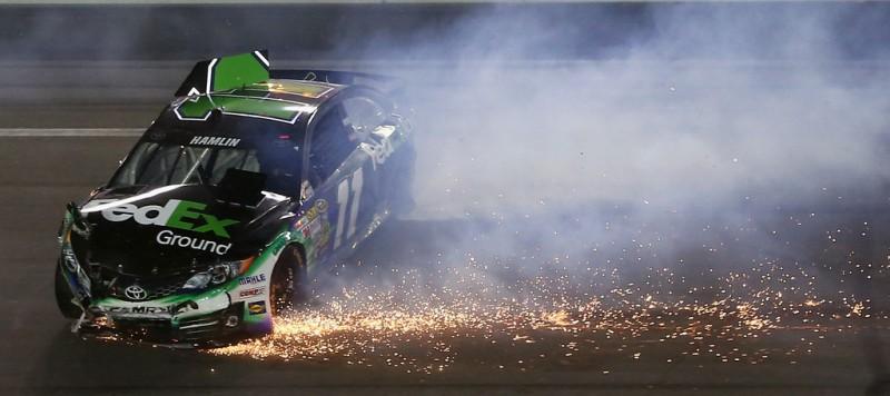 Denny Hamlin, driver of the #11 FedEx Ground Toyota, crashes during the NASCAR Sprint Cup Series Coke Zero 400 at Daytona International Speedway on July 6, 2013 in Daytona Beach, Florida.