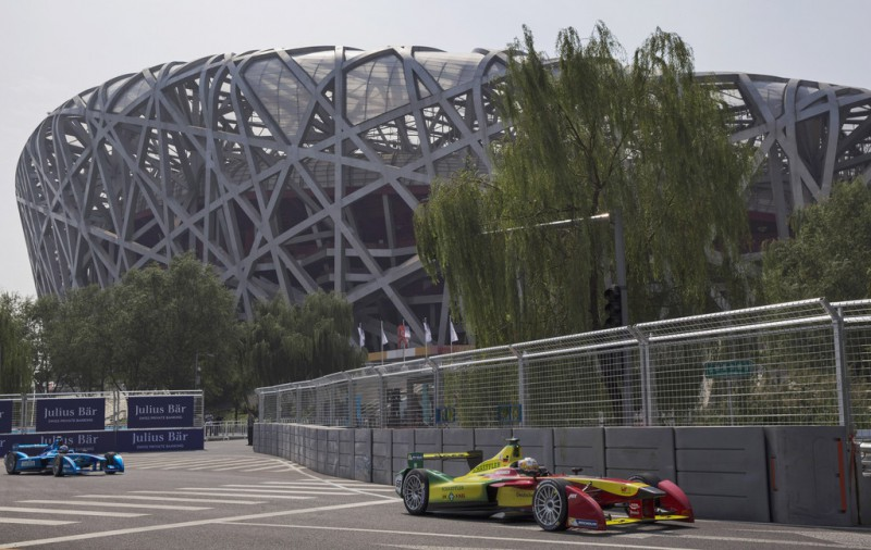 Audi Sport ABT driver Daniel Abt drives through a turn during qualifying at the inaugral FIA Formula E Bejing ePrix Championship on September 13, 2014 in Beijing, China. The electric car racing series, is backed by many of the major sponsors of the main Formula One circuit, and is set to be hosted in nine other cities worldwide.