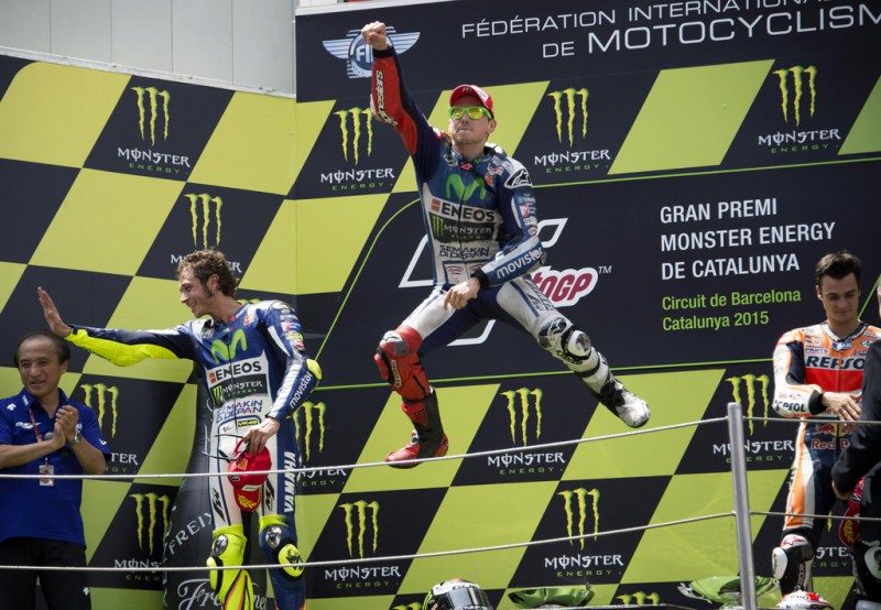(L-R) Valentino Rossi of Italy and Movistar Yamaha MotoGP, Jorge Lorenzo of Spain and Repsol Honda Team and Dani Pedrosa of Spain and Repsol Honda Team celebrate on the podium at the end of the MotoGP race during the MotoGp of Catalunya - Race at Circuit de Catalunya on June 14, 2015 in Montmelo, Spain.
