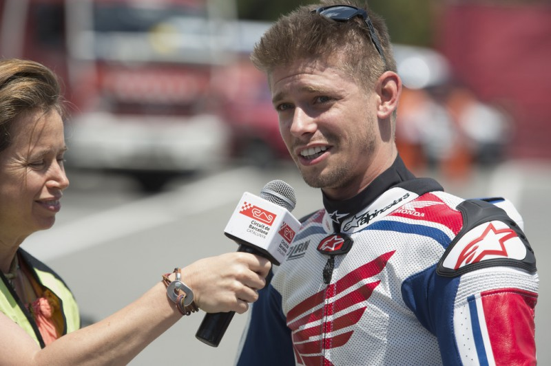 Casey Stoner of Australia speaks with a journalist before the MotoGP race during the MotoGp of Catalunya - Race at Circuit de Catalunya on June 14, 2015 in Montmelo, Spain.