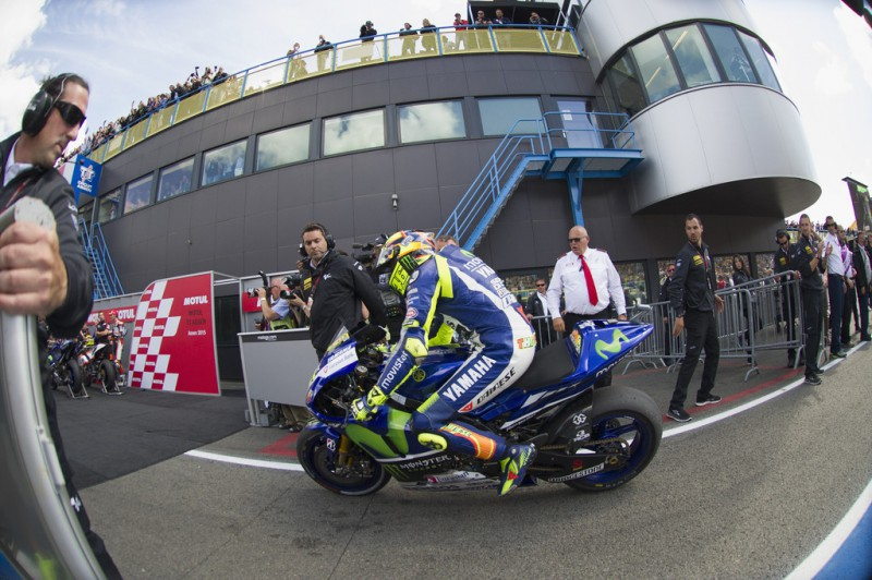 Valentino Rossi of Italy and Movistar Yamaha MotoGP celebrates the victory under the podium at the end of the MotoGP race during the MotoGP Netherlands - Race at on June 27, 2015 in Assen, Netherlands.