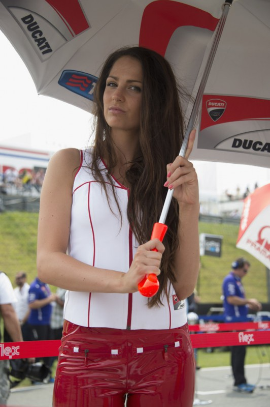 A grid girl poses on the grid during the MotoGP race during the MotoGp of Germany - Race at Sachsenring Circuit on July 12, 2015 in Hohenstein-Ernstthal, Germany.