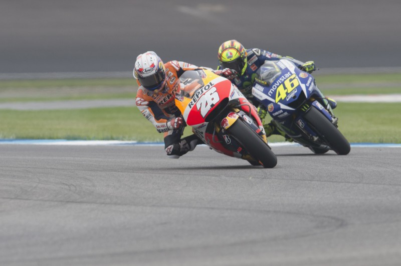 Dani Pedrosa of Spain and Repsol Honda Team leads Valentino Rossi of Italy and Movistar Yamaha MotoGP during the MotoGP race during the MotoGp Red Bull U.S. Indianapolis Grand Prix - Race at Indianapolis Motor Speedway on August 9, 2015 in Indianapolis, Indiana.