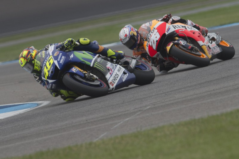 Valentino Rossi of Italy and Movistar Yamaha MotoGP leads Dani Pedrosa of Spain and Repsol Honda Team during the MotoGP race during the MotoGp Red Bull U.S. Indianapolis Grand Prix - Race at Indianapolis Motor Speedway on August 9, 2015 in Indianapolis, Indiana.