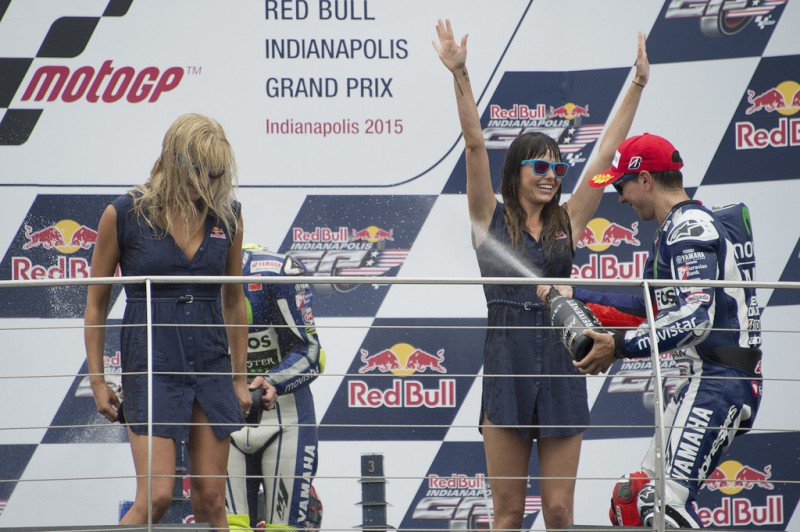 Jorge Lorenzo of Spain and Movistar Yamaha MotoGP celebrates the second place on the podium with the girls at the end of the MotoGP race during the MotoGp Red Bull U.S. Indianapolis Grand Prix - Race at Indianapolis Motor Speedway on August 9, 2015 in Indianapolis, Indiana.