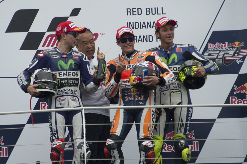 (L-R) Jorge Lorenzo of Spain and Movistar Yamaha MotoGP, Shuhei Nakamoto of Japan and Honda Racing Competition HRC , Marc Marquez of Spain and Repsol Honda Team and Valentino Rossi of Italy and Movistar Yamaha MotoGP pose on the podium at the end of the MotoGP race during the MotoGp Red Bull U.S. Indianapolis Grand Prix - Race at Indianapolis Motor Speedway on August 9, 2015 in Indianapolis, Indiana.