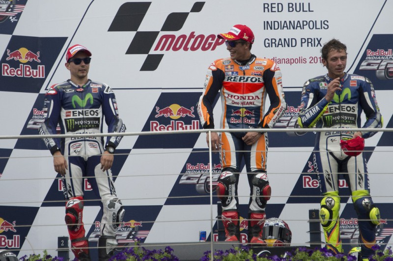 (L-R) Jorge Lorenzo of Spain and Movistar Yamaha MotoGP, Marc Marquez of Spain and Repsol Honda Team and Valentino Rossi of Italy and Movistar Yamaha MotoGP pose on the podium at the end of the MotoGP race during the MotoGp Red Bull U.S. Indianapolis Grand Prix - Race at Indianapolis Motor Speedway on August 9, 2015 in Indianapolis, Indiana.