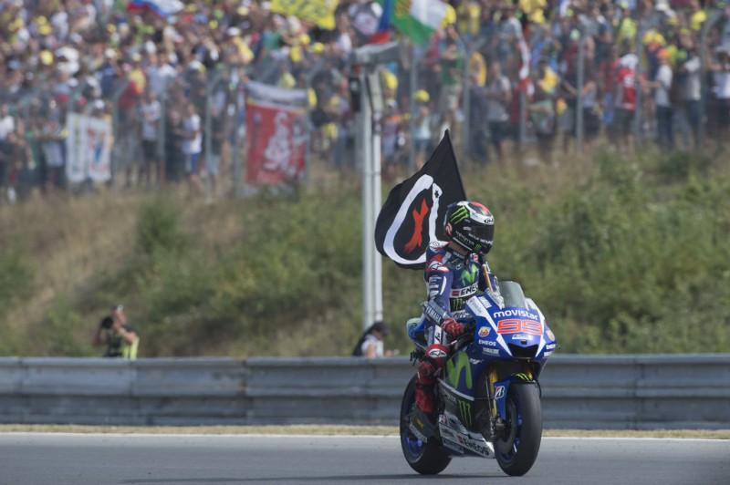Jorge Lorenzo of Spain and Movistar Yamaha MotoGP celebrates the victory with flag at the end of the MotoGP race during the MotoGp of Czech Republic - Race at Brno Circuit on August 16, 2015 in Brno, Czech Republic.