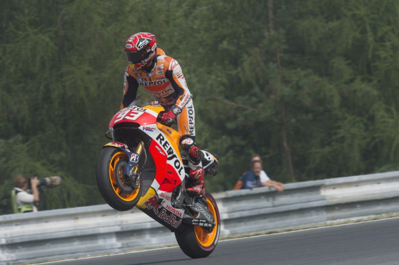 Marc Marquez of Spain and Repsol Honda Team lifts the front wheel and celebrates the second place at the end of the MotoGP race during the MotoGp of Czech Republic - Race at Brno Circuit on August 16, 2015 in Brno, Czech Republic.