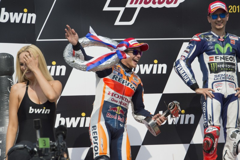 Marc Marquez of Spain and Repsol Honda Team celebrates the second place on the podium at the end of the MotoGP race during the MotoGp of Czech Republic - Race at Brno Circuit on August 16, 2015 in Brno, Czech Republic.