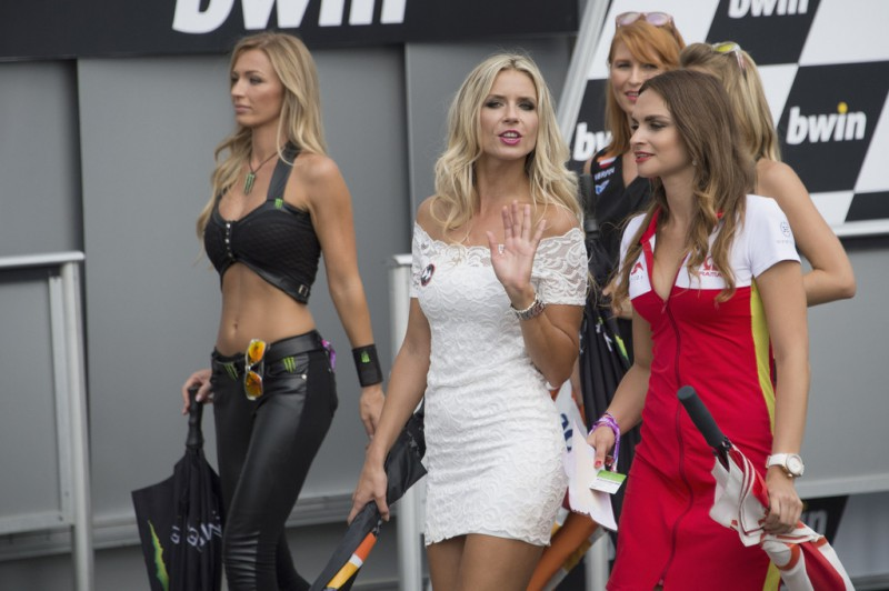 The grid girls walk out of the grid during the MotoGP race during the MotoGp of Czech Republic - Race at Brno Circuit on August 16, 2015 in Brno, Czech Republic.