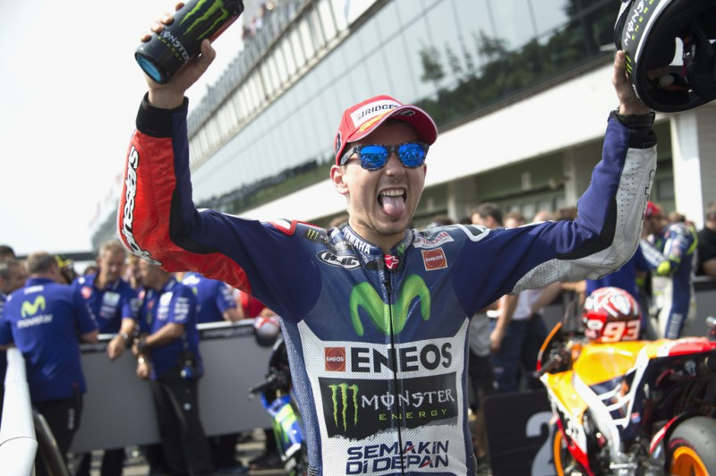 Jorge Lorenzo of Spain and Movistar Yamaha MotoGP celebrates the victory under the podium at the end of the MotoGP race during the MotoGp of Czech Republic - Race at Brno Circuit on August 16, 2015 in Brno, Czech Republic.