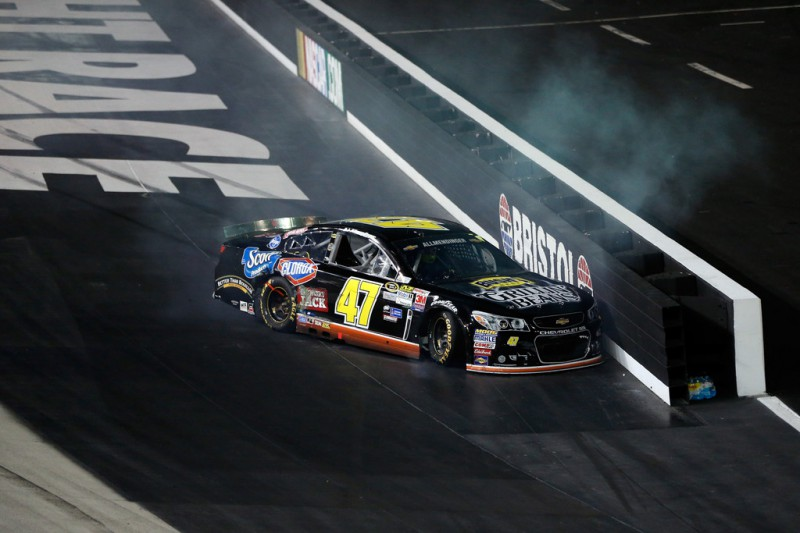 AJ Allmendinger, driver of the #47 Bush's Grillin Beans Chevrolet, has an on track incident during the NASCAR Sprint Cup Series IRWIN Tools Night Race at Bristol Motor Speedway on August 22, 2015 in Bristol, Tennessee.