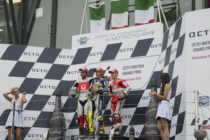 (L-R) Danilo Petrucci of Italy and Pramac Racing, Valentino Rossi of Italy and Movistar Yamaha MotoGP, Andrea Dovizioso of Italy and Ducati Team pose on the podium at the end of the MotoGP race during the MotoGp Of Great Britain - Race at Silverstone Circuit on August 30, 2015 in Northampton, United Kingdom.