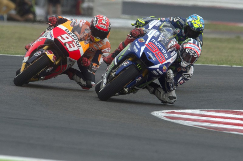 Jorge Lorenzo of Spain and Movistar Yamaha MotoGP leads Marc Marquez of Spain and Repsol Honda Team in the MotoGP World Championship race during the San Marino GP at Misano World Circuit on September 13, 2015 in Misano Adriatico, Italy.