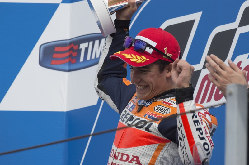 Marc Marquez of Spain and Repsol Honda Team celebrates the victory on the podium after the MotoGP World Championship race during the San Marino GP at Misano World Circuit on September 13, 2015 in Misano Adriatico, Italy.