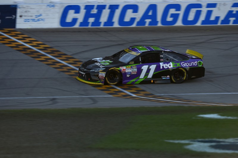 Denny Hamlin, driver of the #11 FedEx Ground Toyota, crosses the finish-line to win the NASCAR Sprint Cup Series myAFibRisk.com 400 at Chicagoland Speedway on September 20, 2015 in Joliet, Illinois.