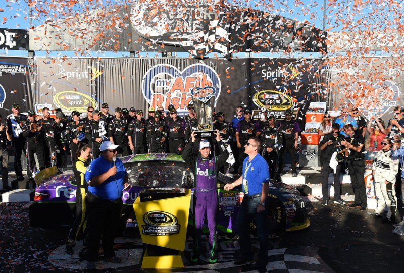 Denny Hamlin, driver of the #11 FedEx Ground Toyota, celebrates in Victory Lane after winning the NASCAR Sprint Cup Series myAFibRisk.com 400 at Chicagoland Speedway on September 20, 2015 in Joliet, Illinois.