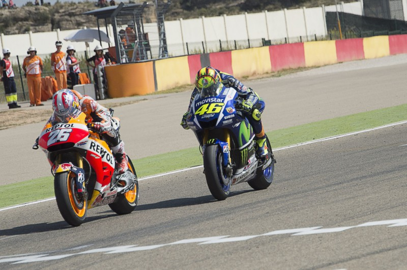 Dani Pedrosa of Spain and Repsol Honda Team leads Valentino Rossi of Italy and Movistar Yamaha MotoGP during the MotoGP race during the MotoGP of Spain - Race at Motorland Aragon Circuit on September 27, 2015 in Alcaniz, Spain.