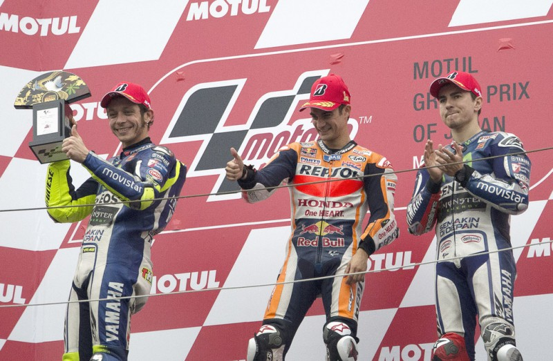 (L-R) Valentino Rossi of Italy and Movistar Yamaha MotoGP, Dani Pedrosa of Spain and Repsol Honda Team and Jorge Lorenzo of Spain and Movistar Yamaha MotoGP celebrate on the podium at the end of the MotoGP race during the MotoGP Of Japan - Race at Twin Ring Motegi on October 11, 2015 in Motegi, Japan.