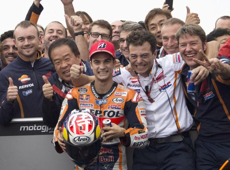 Dani Pedrosa of Spain and Repsol Honda Team celebrates the victory with team under the podium at the end of the MotoGP race during the MotoGP Of Japan - Race at Twin Ring Motegi on October 11, 2015 in Motegi, Japan.
