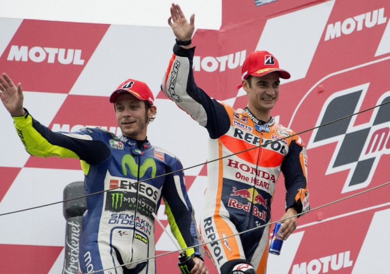 Dani Pedrosa of Spain and Repsol Honda Team celebrates with Valentino Rossi of Italy and Movistar Yamaha MotoGP (L) on the podium at the end of the MotoGP race during the MotoGP Of Japan - Race at Twin Ring Motegi on October 11, 2015 in Motegi, Japan.