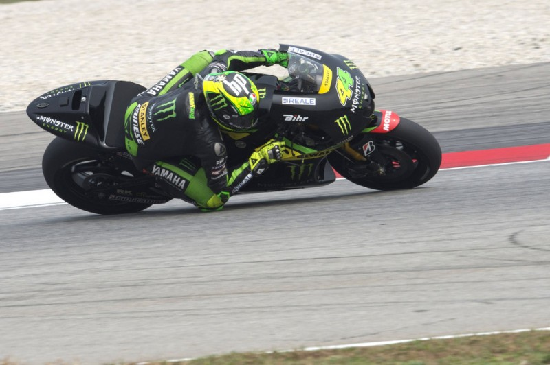 Pol Espargaro of Spain and Monster Yamaha Tech 3 rounds the bend. during the MotoGP race during the MotoGP Of Malaysia at Sepang Circuit on October 25, 2015 in Kuala Lumpur, Malaysia.