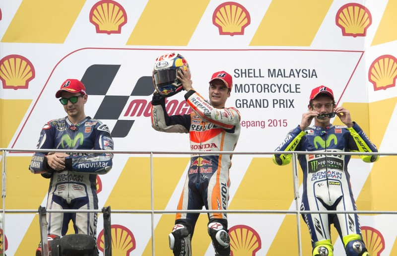 (L-R) Jorge Lorenzo of Spain and Movistar Yamaha MotoGP, Dani Pedrosa of Spain and Repsol Honda Team and Valentino Rossi of Italy and Movistar Yamaha MotoGP celebrate on the podium at the end of the MotoGP race during the MotoGP Of Malaysia - Race at Sepang Circuit on October 25, 2015 in Kuala Lumpur, Malaysia.
