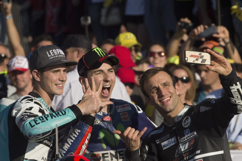 (L-R) Danny Kent of Britain and Leopard Racing, Jorge Lorenzo of Spain and Movistar Yamaha MotoGP and Johann Zarco of Frence and AJO Motorsport pose for a selfie to celebrate the three Champions of the 2015 season during the MotoGP Race at Ricardo Tormo Circuit on November 8, 2015 in Valencia, Spain.