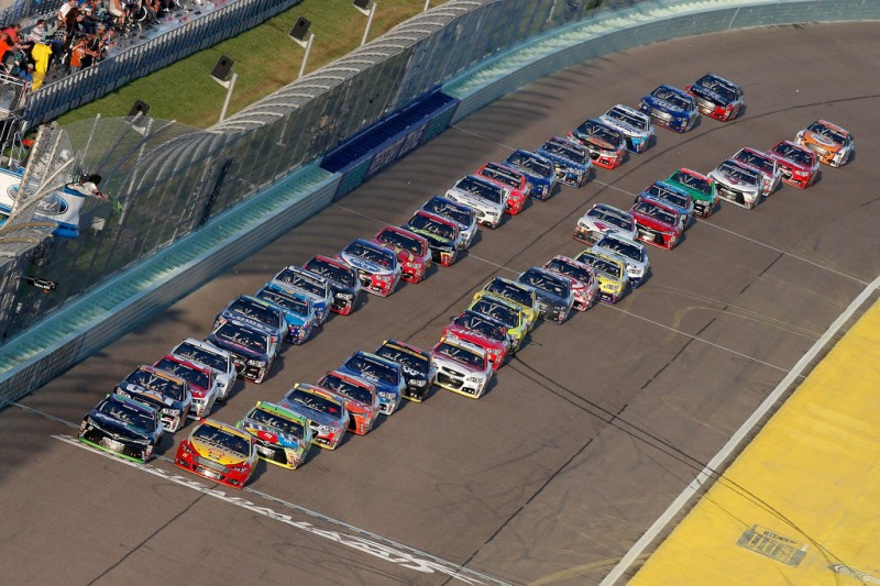 Denny Hamlin, driver of the #11 FedEx Ground Toyota, and Joey Logano, driver of the #22 Shell Pennzoil Ford, leads the field past the green flag to start the NASCAR Sprint Cup Series Ford EcoBoost 400 at Homestead-Miami Speedway on November 22, 2015 in Homestead, Florida.