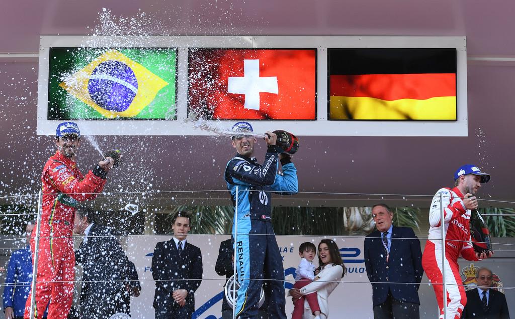 In this handout image supplied by Formula E, Sebastien Buemi (SUI), Renault e.Dams, Spark-Renault, Renault Z.E 16, 1st; Lucas Di Grassi (BRA), ABT Schaeffler Audi Sport, Spark-Abt Sportsline, ABT Schaeffler FE02, 2nd; Nick Heidfeld (GER), Mahindra Racing, Spark-Mahindra, Mahindra M3ELECTRO, 3rd, n the podium during the FIA Formula E Championship Monaco ePrix on May 13, 2017 in Monte-Carlo, Monaco.