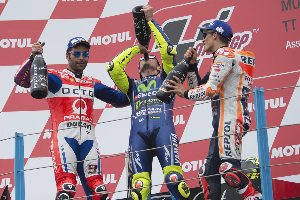 Danilo Petrucci of Italy and Octo Pramac Yakhnich, Valentino Rossi of Italy and Movistar Yamaha MotoGP and Marc Marquez of Spain and Repsol Honda Team celebrate on the podium at the end of the MotoGP Race during the MotoGP Netherlands - Race on June 25, 2017 in Assen, Netherlands.