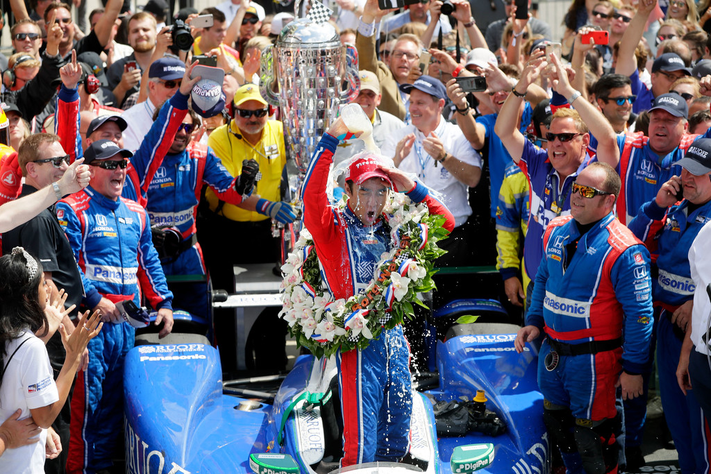 Takuma Sato of Japan, driver of the #26 Andretti Autosport Honda, celebrates in Victory Lane after winning the 101st running of the Indianapolis 500 at Indianapolis Motorspeedway on May 28, 2017 in Indianapolis, Indiana.