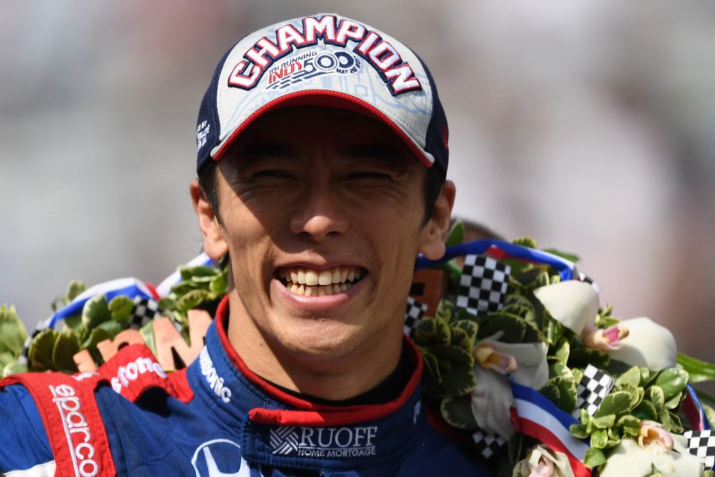 Takuma Sato of Japan, driver of the #26 Andretti Autosport Honda, celebrates after winning the 101st Indianapolis 500 at Indianapolis Motorspeedway on May 28, 2017 in Indianapolis, Indiana.