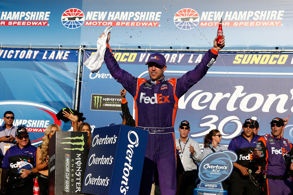 Denny Hamlin, driver of the #11 FedEx Office Toyota, celebrates in Victory Lane after winning the Monster Energy NASCAR Cup Series Overton's 301 at New Hampshire Motor Speedway on July 16, 2017 in Loudon, New Hampshire.