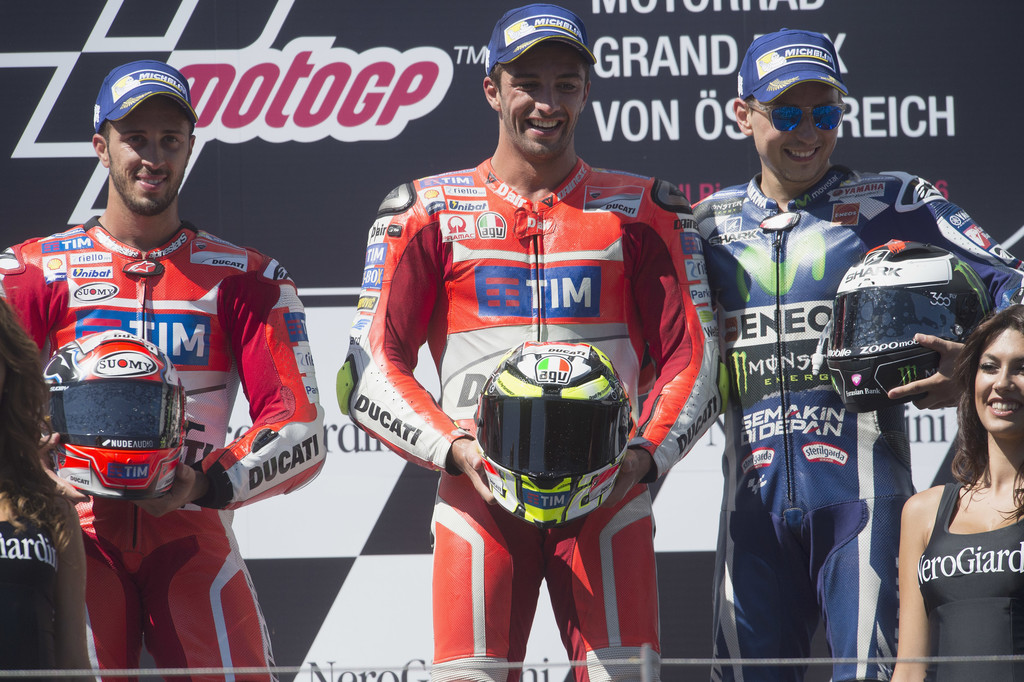 Andrea Dovizioso of Italy and Ducati Team, Andrea Iannone of Italy and Ducati Team and Jorge Lorenzo of Spain and Movistar Yamaha MotoGP celebrate on the podium at the end of the MotoGp race during the MotoGp of Austria - Race at Red Bull Ring on August 14, 2016 in Spielberg, Austria.