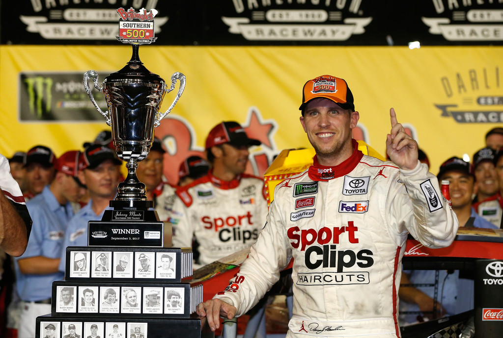 Denny Hamlin, driver of the #11 Sport Clips Toyota, poses with the trophy in Victory Lane after winning the Monster Energy NASCAR Cup Series Bojangles' Southern 500 at Darlington Raceway on September 3, 2017 in Darlington, South Carolina.