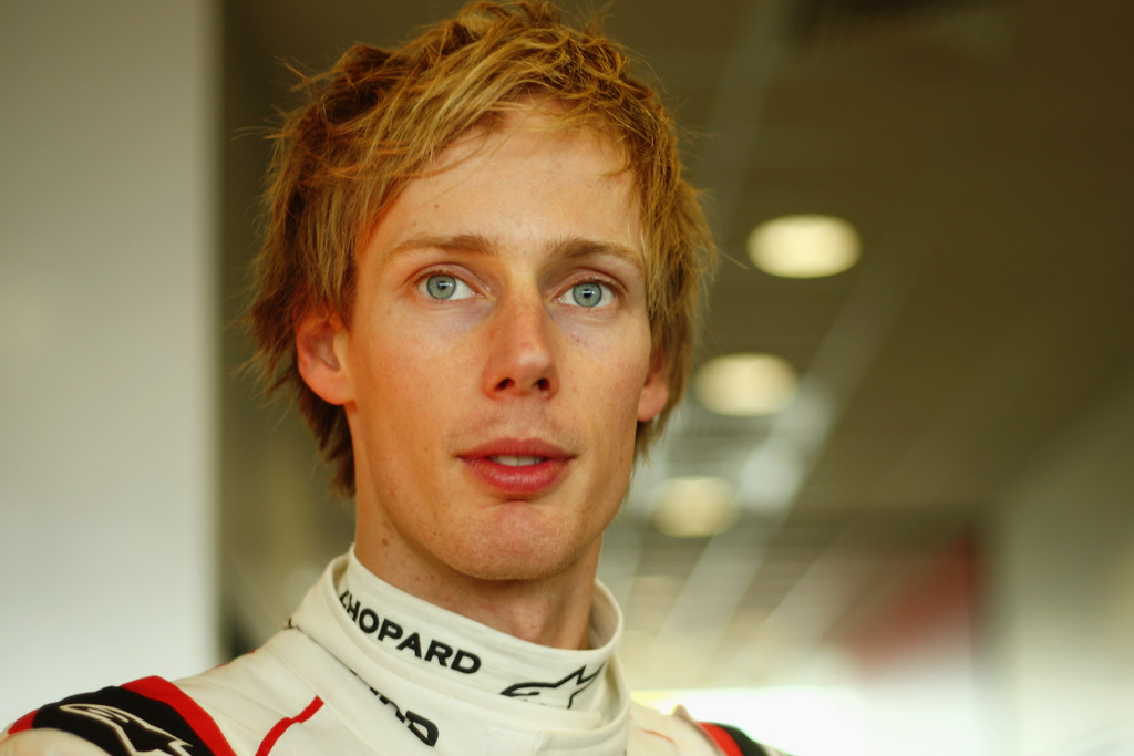 Brendon Hartley of New Zealand and Porsche Team 919 Hybrid talks to the media during previews the FIA World Endurance Championship Six Hours of Silverstone race at the Silverstone Circuit on April 16, 2016 in Northampton, England.