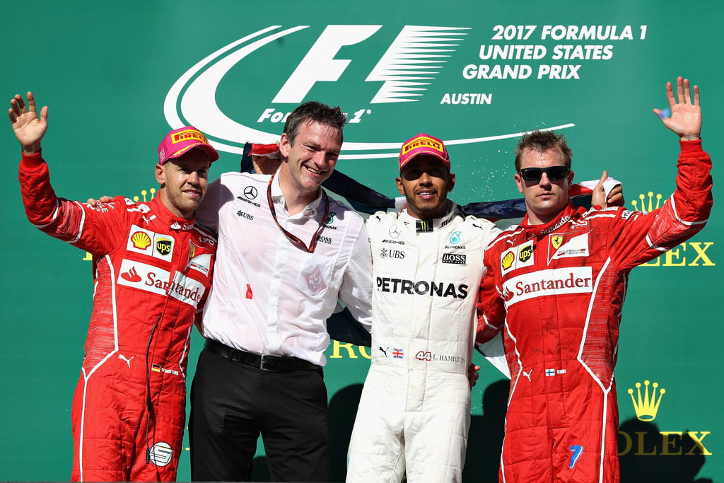 Top three finishers Lewis Hamilton of Great Britain and Mercedes GP, Sebastian Vettel of Germany and Ferrari, Kimi Raikkonen of Finland and Ferrari and James Allison, Technical Director at Mercedes GP celebrate on the podium during the United States Formula One Grand Prix at Circuit of The Americas on October 22, 2017 in Austin, Texas.