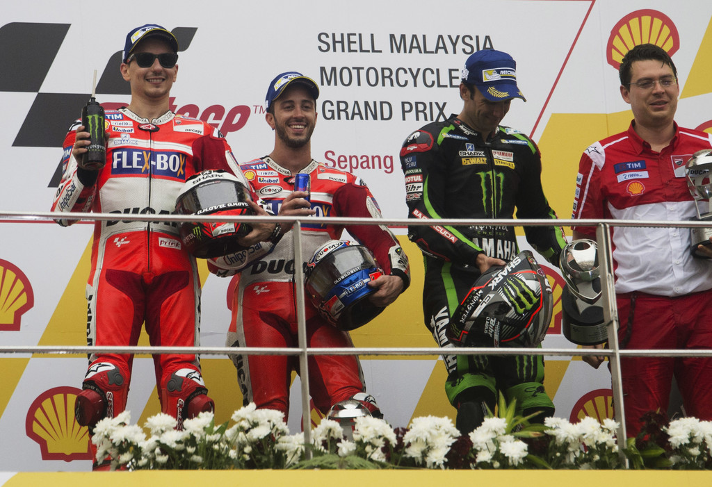 (L-R) Jorge Lorenzo of Spain and Ducati Team, Andrea Dovizioso of Italy and Ducati Team and Johann Zarco of France and Monster Yamaha Tech 3 celebrate on the podium at the end of the MotoGP race during the MotoGP Of Malaysia - Race at Sepang Circuit on October 29, 2017 in Kuala Lumpur, Malaysia.