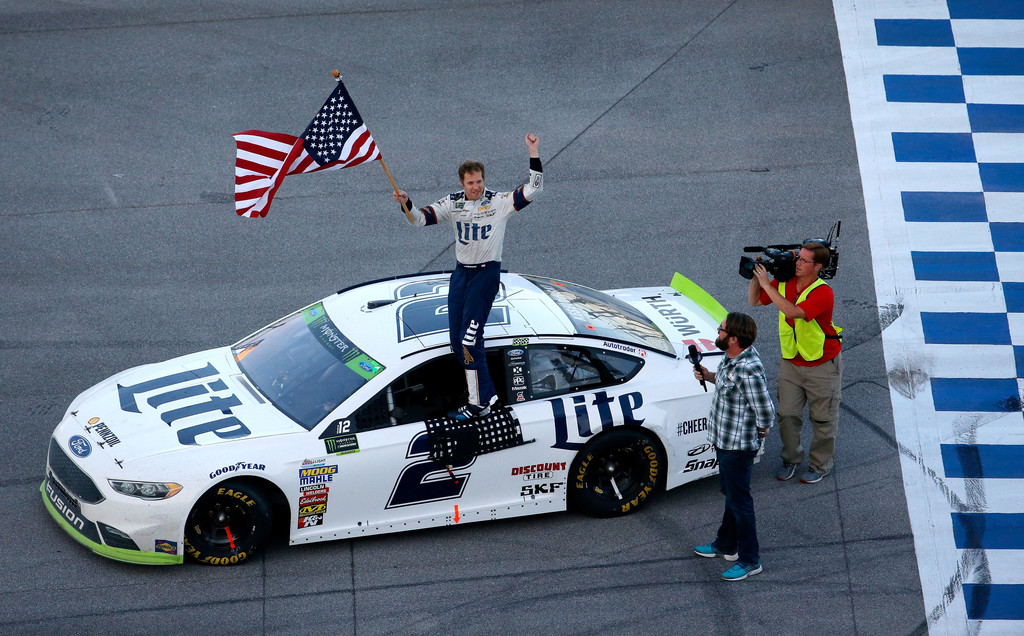 Brad Keselowski, driver of the #2 Miller Lite Ford, celebrates after winning the Monster Energy NASCAR Cup Series Alabama 500 at Talladega Superspeedway on October 15, 2017 in Talladega, Alabama.