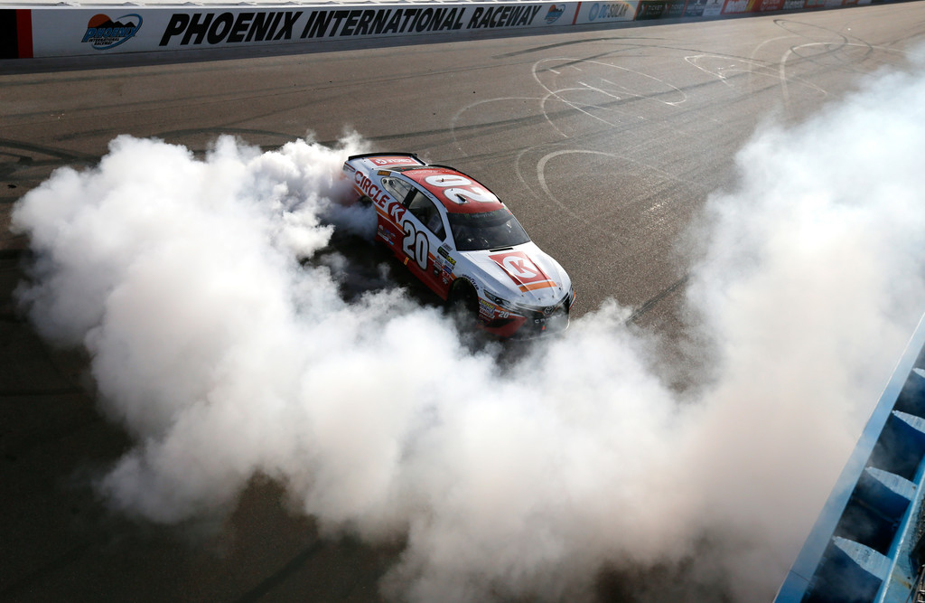 Matt Kenseth, driver of the #20 Circle K Toyota, celebrates with a burnout after winning the Monster Energy NASCAR Cup Series Can-Am 500 at Phoenix International Raceway on November 12, 2017 in Avondale, Arizona.