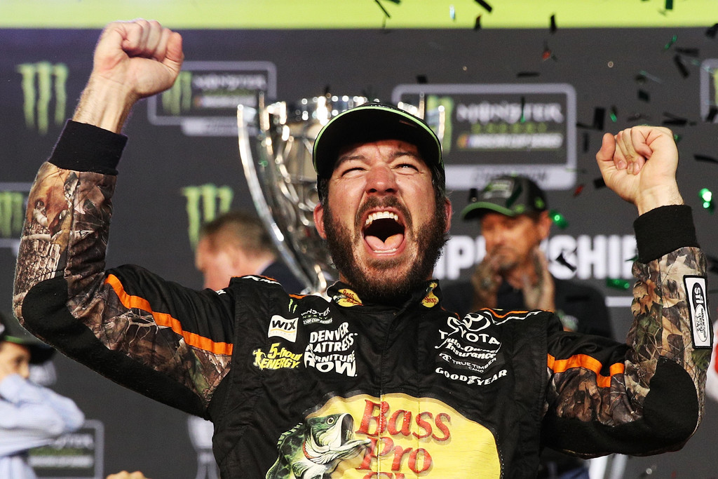 Martin Truex Jr., driver of the #78 Bass Pro Shops/Tracker Boats Toyota, in Victory Lane after winning the Monster Energy NASCAR Cup Series Championship and the Monster Energy NASCAR Cup Series Championship Ford EcoBoost 400 at Homestead-Miami Speedway on November 19, 2017 in Homestead, Florida.