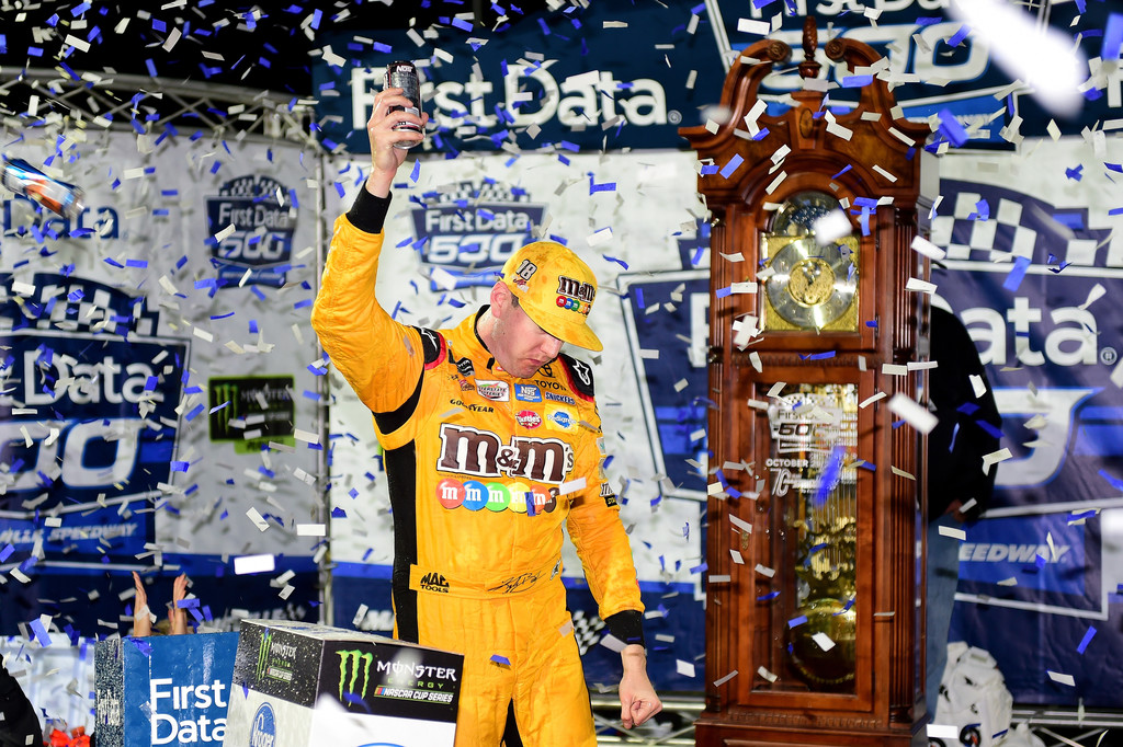 Kyle Busch, driver of the #18 M&M's Halloween Toyota, celebrates in Victory Lane after winning the Monster Energy NASCAR Cup Series First Data 500 at Martinsville Speedway on October 29, 2017 in Martinsville, Virginia.