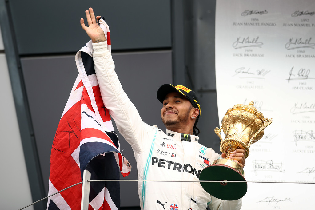 Race winner Lewis Hamilton of Great Britain and Mercedes GP celebrates on the podium during the F1 Grand Prix of Great Britain at Silverstone on July 14, 2019 in Northampton, England.