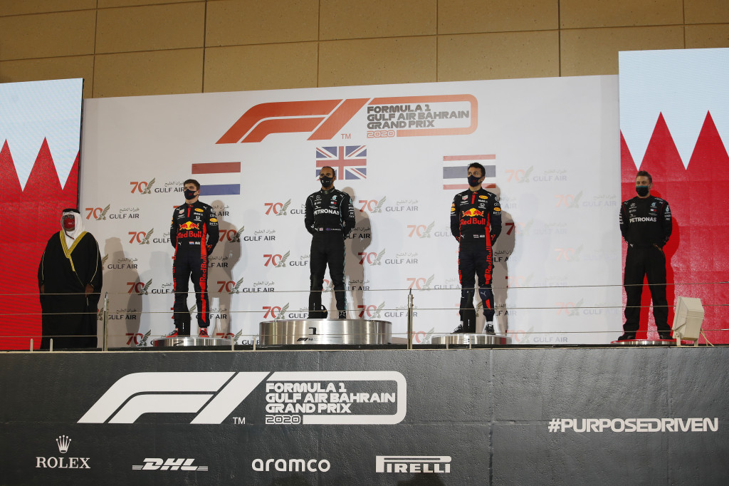 Race winner Lewis Hamilton of Great Britain and Mercedes GP, second placed Max Verstappen of Netherlands and Red Bull Racing and third placed Alexander Albon of Thailand and Red Bull Racing stand on the podium during the F1 Grand Prix of Bahrain at Bahrain International Circuit on November 29, 2020 in Bahrain, Bahrain.