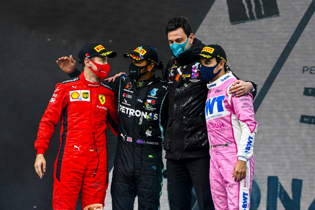 Lewis Hamilton sealed his seventh world championship with victory at a rain-affected Turkish Grand Prix. Sergio Perez and Sebastian Vettel joined him in the top three for their first podium finishes of the year.