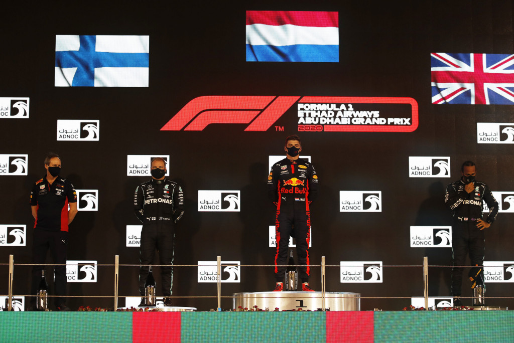 Race winner Max Verstappen of Netherlands and Red Bull Racing, second placed Valtteri Bottas of Finland and Mercedes GP, third placed Lewis Hamilton of Great Britain and Mercedes GP and Red Bull Racing Head of Car Engineering Paul Monaghan celebrate on the podium during the F1 Grand Prix of Abu Dhabi at Yas Marina Circuit on December 13, 2020 in Abu Dhabi, United Arab Emirates.