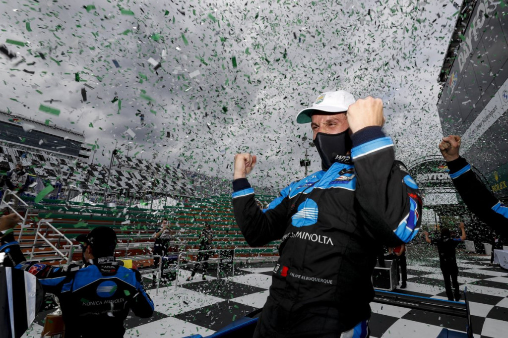 Filipe Albuquerque and his teammates Helio Castroneves, Alexander Rossi and Ricky Taylor celebrate victory in 2021 Rolex 24 at Daytona.